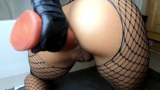Lilly plays with her ass, fisting as a foreplay then she inserts various strange objects and shows us some serious deep anal play with a with Ball, Buttplug, & Slink