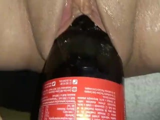 One Litter Coke Bottle stretching some loose amateur